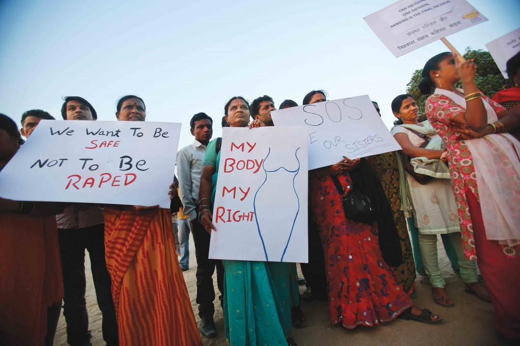 Demonstrators hold placards as they take part in a protest rally in solidarity with a rape victim from New Delhi in Mumbai